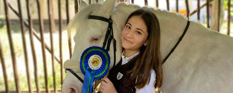 Güneş Er from Secondary School, First Old in Equestrian Competition.